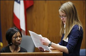 Witness Kirsten Clark, left, answers questions from attorney Kayla Adolph of St. Ursula Academy during the Mock Trial Competition in Toledo Municipal Court on Friday. Ms. Clark won an award as an outstanding witness. She said it was 'just a great experience.'