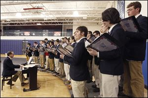 Nick Dombi, Jack Dowd, and Ethon Pawlaczyk, from left, are among singers at a Mass in which eight students at St. Francis de Sales High School were 'knighted.'