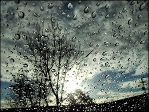 Raindrops appear on a windshield following the first rain of the year, early Thursday, Jan. 30, 2014, in Novato, Calif.