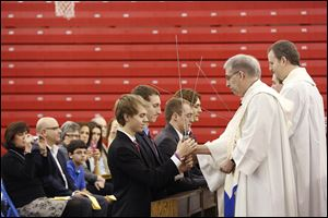 Benjamin Steingass, Daniel Siebenaller, David Nees, and John Kulka, from left, are among eight stu-dents at St. Francis de Sales High School who were 'knighted'  during ceremonies Friday.