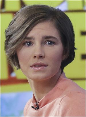 Amanda Knox prepares to leave the set following a television interview on 'Good Morning America' today.
