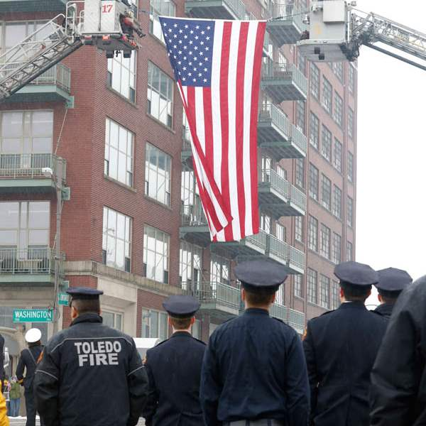 Toledo-firefighters-put-up-the-large-American-flag-at-the-c