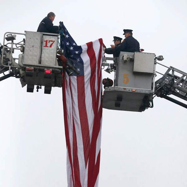 Toledo-firefighters-put-up-the-large-American-flag