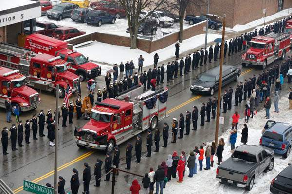 A-Toledo-Fire-Department-truck-carries-a-flag-dra