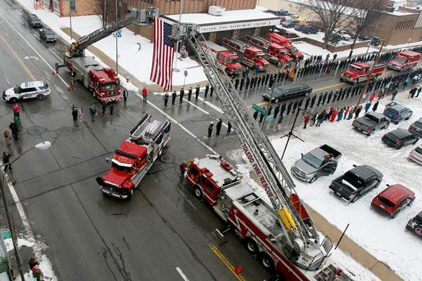 A-Toledo-Fire-Department-truck-carries-a-flag-draped-coffin-p