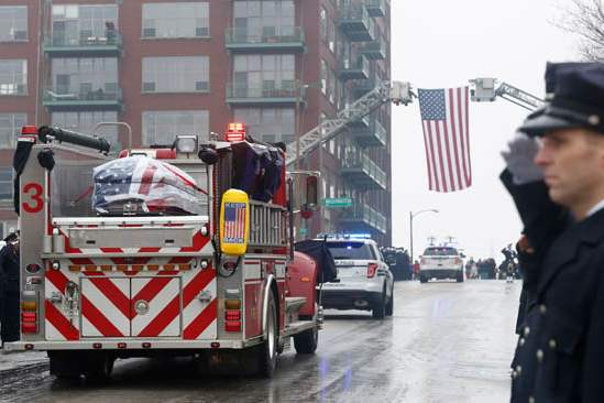 Firefighters-salute-during-the-procession