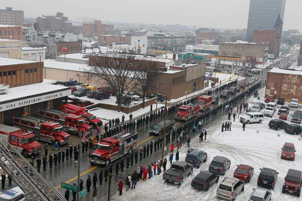 North-Ontario-Street-in-lined-with-firefighters-and-and-frien