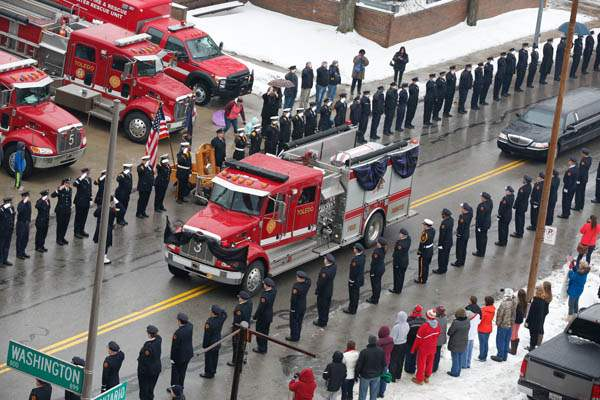 Toledo-Fire-Department-members-salute-as-fire-tr