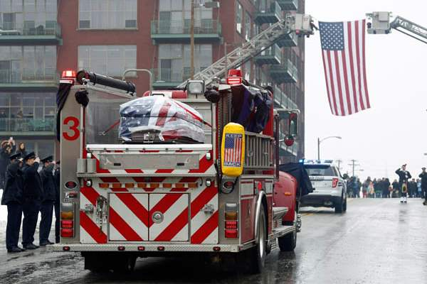 Toledo-Firefighters-salute-as-the-casket-of-Toledo-Firefighter-Stephen-Machcinski