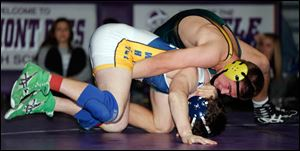 Oregon Clay's Matt Stencel defeats Whitmer's Jacob LaPoint by pin fall in the 195 pound championship match.