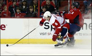 Detroit Red Wings left wing Justin Abdelkader, left, and Washington Capitals right wing Alex Ovechkin collide in the first period on Sunday in Washington.