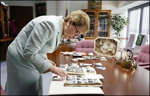 U.S. Rep. Marcy Kaptur (D., Toledo) looks over family pictures on her desk. Miss Kaptur's grandparents were both born in Ukraine, and she worries about that nation's future. She plans to bring some Ukrainian farmers here on a trade mission this month.