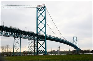 Officials hope to open the New International Trade Crossing over the Detroit River by 2020. If so, it would compete with the Ambassador Bridge, above.