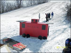 Whitehouse's Wacky Sled Races feature some imaginative entries, such as a pirate ship or this caboose.
