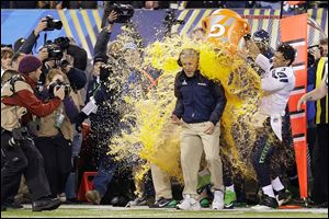 Seattle's Pete Carroll is doused with sports drink in celebration of winning Super Bowl XLVIII.