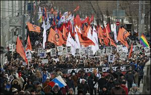 Several thousand Russian opposition supporters gathered for a protest on Sunday, venting anger against the Kremlin and demanding the release of political prisoners.