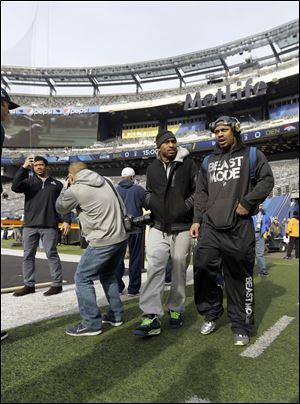 Seattle Seahawks quarterback Russell Wilson, left, and running back Marshawn Lynch, right, make a brief visit to MetLife Stadium.