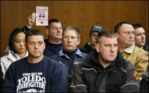 A large group of Toledo firefighters attend the arraignment of Ray Abou-Arab in Toledo Municipal Court. Mr. Abou-Arab is charged with aggravated arson and two counts of aggravated murder in the deaths of Toledo firefighters Stephen A. Machcinski and James Dickman.
