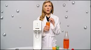 "SodaStream's ad features ""Her"" actress Scarlett Johansson promoting its at-home soda maker."