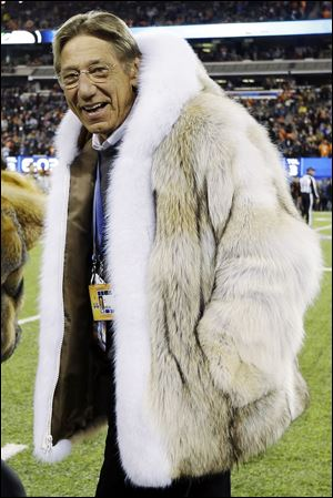 Former New York Jets quarterback Joe Namath walks on the field before the NFL Super Bowl XLVIII on Sunday.