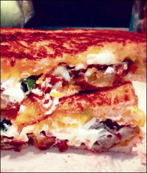 Loaded baked-potato grilled cheese sandwich.