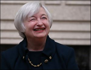 Janet Yellen smiles after being sworn in as Federal Reserve Board Chair, today in Washington.