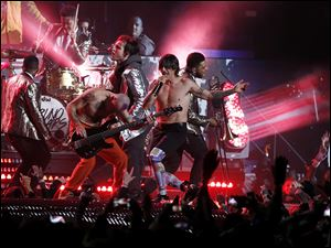 The Red Hot Chili Peppers perform during the halftime show of the NFL Super Bowl XLVIII football game between the Seattle Seahawks and the Denver Broncos.