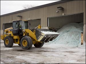 Road salt is unloaded from storage at the public works facility in Glen Ellyn, Ill. The Midwest's recent severe winter weather has caused communities to expend large amounts of their road salt supplies.