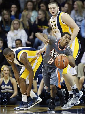BG's Anthony Henderson, center, steals the ball from UT's Rian Pearson during their game last season at Savage Arena.