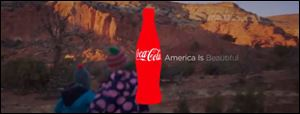 The Coca-Cola TV ad that featured 'America the Beautiful' sung in several languages drew viewers' complaints.
