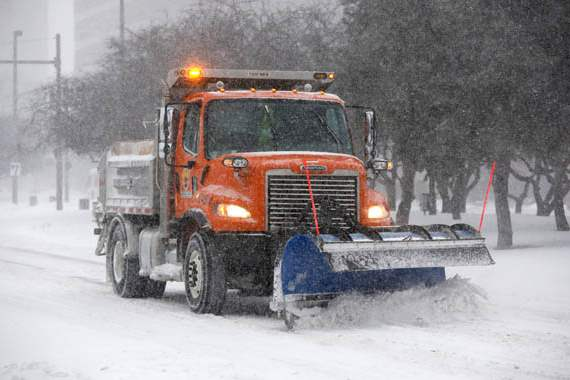 A-City-of-Toledo-snowplow-clears-snow-from-Jackson-Street