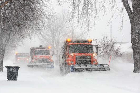 A-trio-of-snow-plows-work-to-clear-290th-Stre