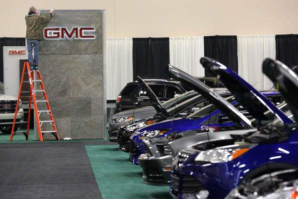 GMC-sign-receives-a-final-polishing-as-Ford-s-cars-are-lined-up