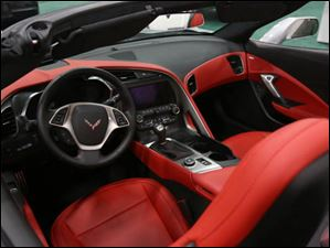 A 2014 Chevrolet Corvette, replete with a red interior.
