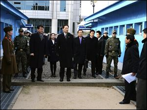Head of South Korean working-level delegation Lee Duk-haeng, center, prepares to cross a border line to hold a meeting with North Korea at Tongilgak in the North Korean side of Panmunjom which has separated the two Koreas since the Korean War.