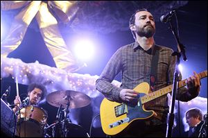 Danger Mouse, aka Brian Burton, left, on drums, and James Mercer of Broken Bells perform in 2010.