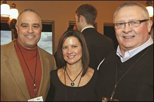 Gus Mancy, left, ticket co-chair Mindy Romanoff, center, and Jim Cameron, right, attended the Taste of The Nation kickoff event at Vistula City Club in Toledo.