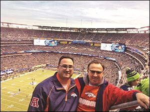 Larry Boyer of Toledo, right, at the Super Bowl with his son Tim Boyer