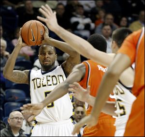 University of Toledo guard Rian Pearson (5) looks for an opening.