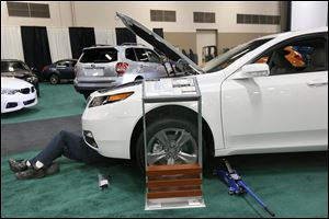 A 2014 Acura TL AWD gets some final preparations in the lead-up to the 2014 Toledo Auto Show at the SeaGate Convention Centre in downtown Toledo.  The show will run today through Sunday.