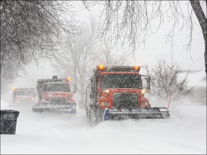 6n5plows-2 Snow plows work to clear 290th Street near Lehman Avenue as snow hammers the area on Wednesday.