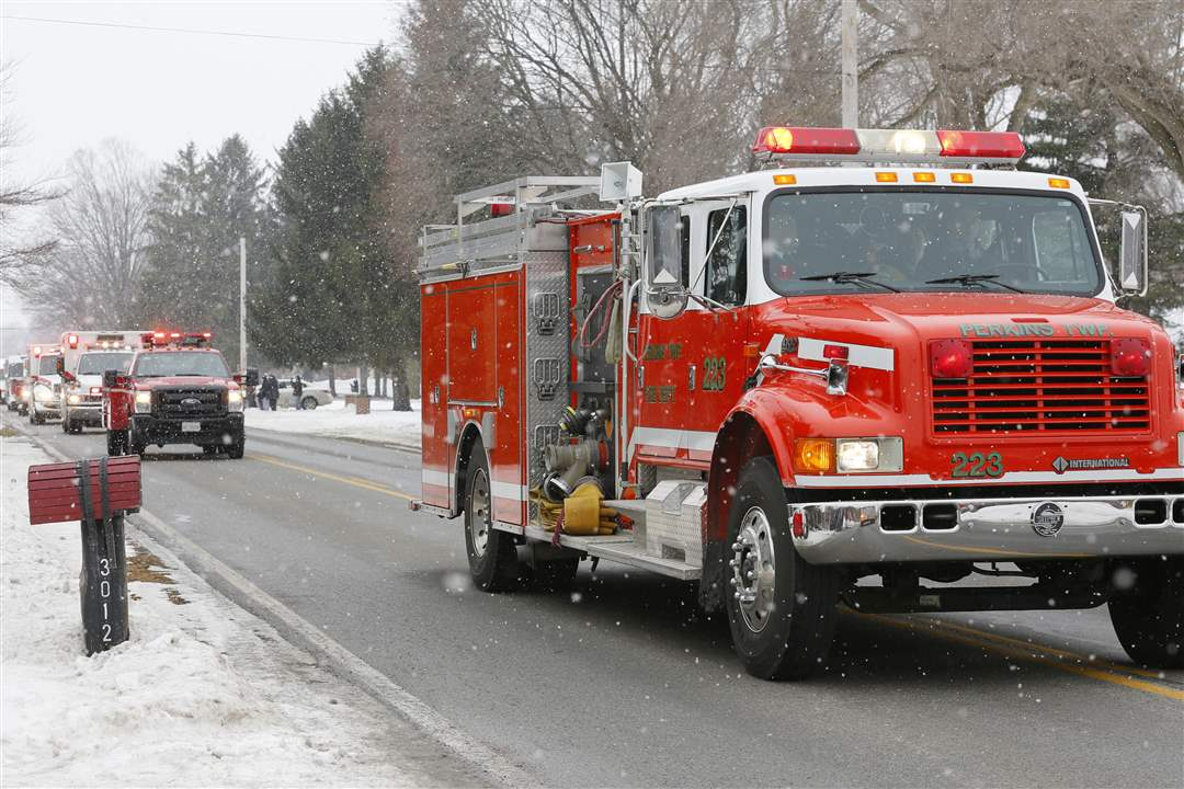 A-Perkins-Township-Fire-truck-heads-past-Perki