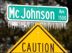 Icicles cling to the McJohnson Avenue street sign Wednesday in Owensboro, Ky.