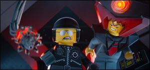 "The character Bad Cop/Good Cop, voiced by Liam Neeson, left, and President Business, voiced by Will Ferrell, in a scene from ""The Lego Movie."""