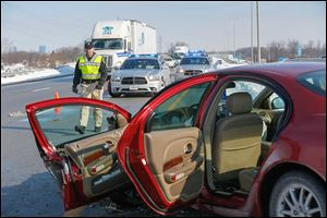 Emergency personnel secure the scene of a wrong-way accident on southbound  I-75 near Buck Road.