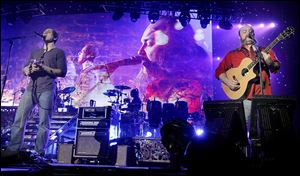 Jimmy De Martini, left, and John Driskell Hopkins perform with the The Zac Brown Band at the Huntington Center.