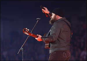 Zac Brown holds the microphone to the sold-out audience at Huntington Center on Wednesday.