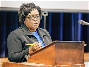 Chere LeGrant, president of ONE Village Council, speaks during a meeting regarding the sale of the North Toledo YMCA.  She sought time for Toledo Public Schools to learn if it will receive a grant.