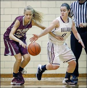 Rossford's Margo Jackson, right, steals the ball from Genoa's Erica Harder. Rossford improved to 13-6 on the season.