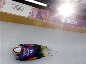 Felix Loch from Germany takes a turn during a training session for the men's singles luge in Krasnaya Polyana, Russia.